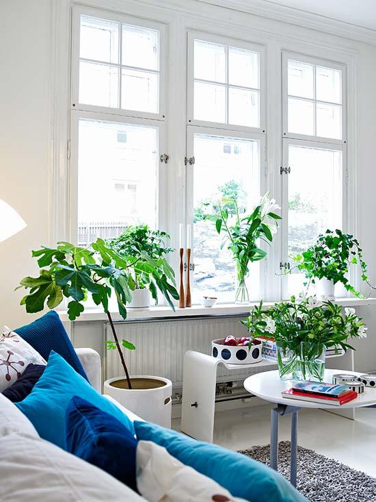 Repisa ventana salón nórdico. Vía: home-designing.com